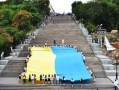 Huge flag of Ukraine unfurled on Potemkin Stairs in Odessa. Photo